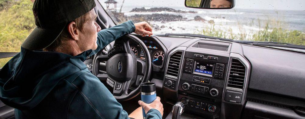 Photo of Man in Car Raining Outside With Yeti Bottle with Hotshot Cap
