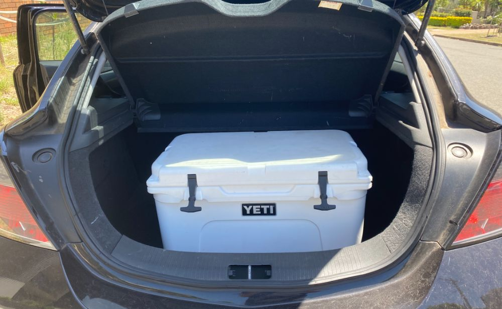 Photo of White Yeti Cooler In Trunk of Car