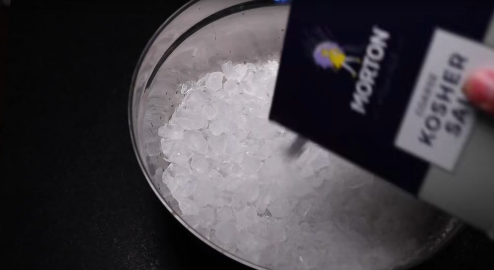 Photo of Pouring Salt into Buck of Ice